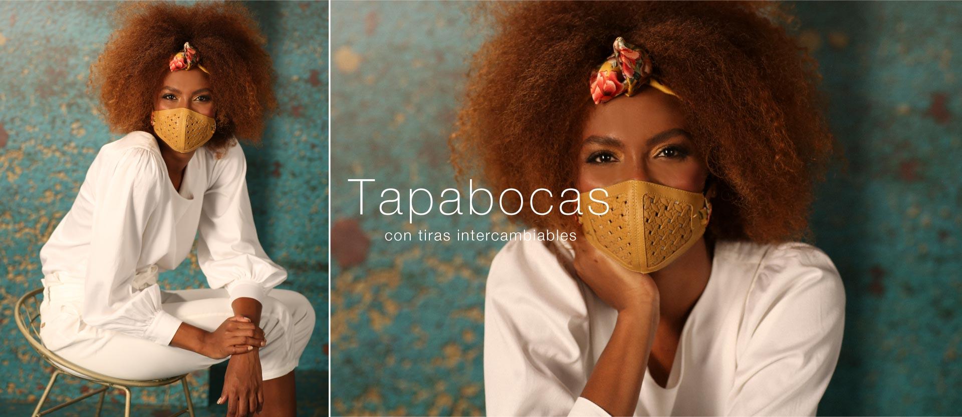Dos mujeres en un lugar con arboles y matorrales. Bolsos en cuero, producto colombiano. Cueros Vélez